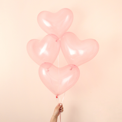 Holding pink clear heart balloons