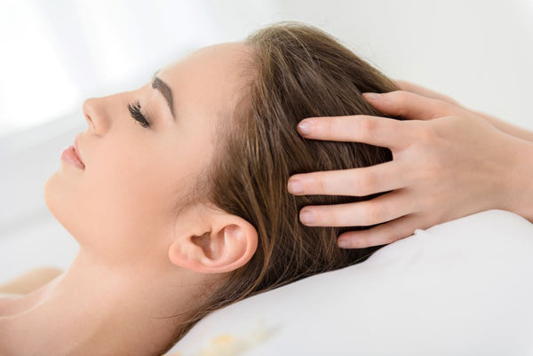 try a warm oil scalp massage