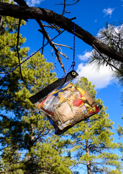RatSack Food and Gear Cache Bag hanging from one tree branch, providing superior backpacking food protection