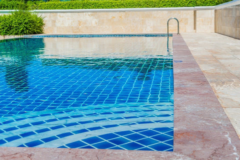 swimming pool surrounded by tile