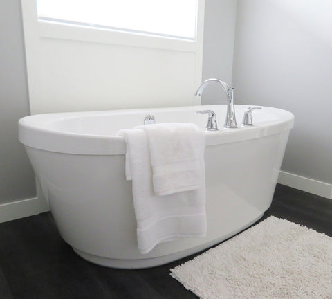 bathtub with white towels