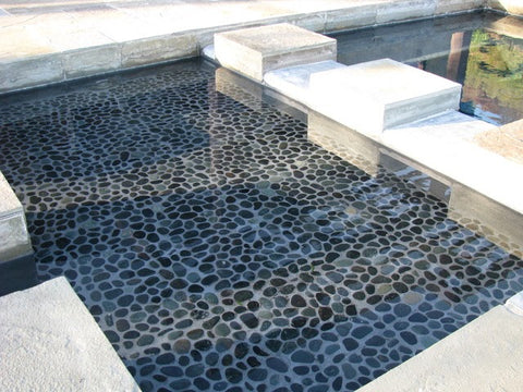 an image of a stone and pebble pool surface