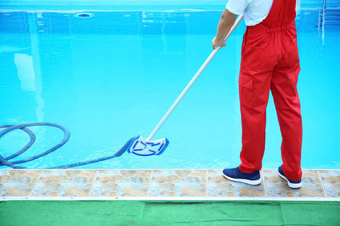 someone cleaning a pool