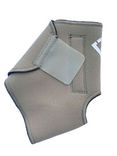 Load image into Gallery viewer, The Bio Magnetic Ankle Support in beige laying flat  with the adhesive closure closed, a strip of 4 of the 8 therapeutic grade magnets can be seen running down the length of the support. The adhesive closure is a slightly lighter colour beige than the neoprene that is used on the support.