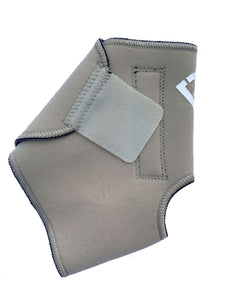 The Bio Magnetic Ankle Support in beige laying flat  with the adhesive closure closed, a strip of 4 of the 8 therapeutic grade magnets can be seen running down the length of the support. The adhesive closure is a slightly lighter colour beige than the neoprene that is used on the support.