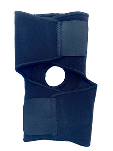 The Bio Magnetic Elbow Support in black laying closed and flat from the back. You can see the adhesive closures are fastened.