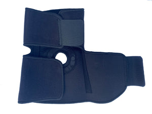 The inside of the Bio Magnetic Elbow Support showing the top half closed securely and the bottom half open showing some of the embedded magnets within the support.