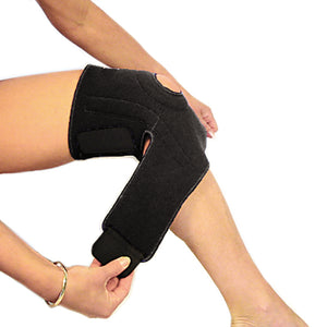 A woman putting on the bio magnetic knee support in the second step. She is fastening the straps around her upper calf, just below her knee. The magnetic knee support featured is in black.