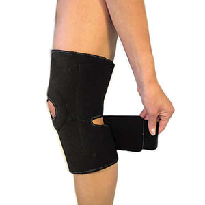 The Bio Magnetic Knee Support in black being fastened with the below strap.