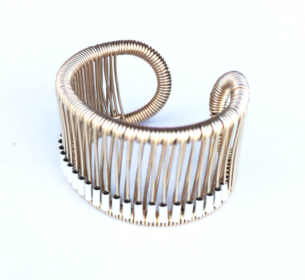 Tana Acton Kinetic Ring in Gold with Silver Tubes