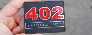 402 Turbo Jet Interior Badge