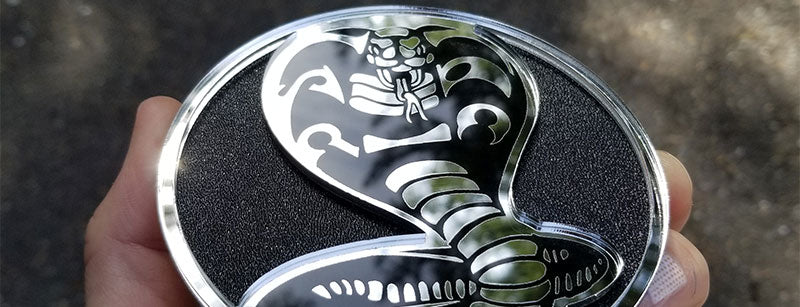 Textured Chrome Round Cobra Emblem