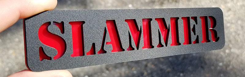 Embossed Matte Black & Red Slammer Emblem