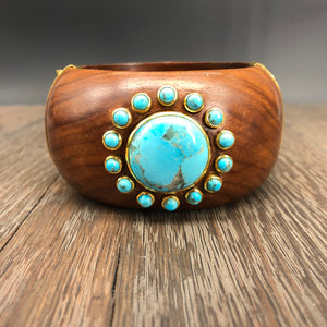 Turquoise accented wooden cuff bracelet