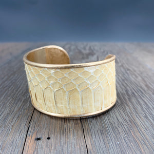 Modern leather cuff bracelet with snakeskin print