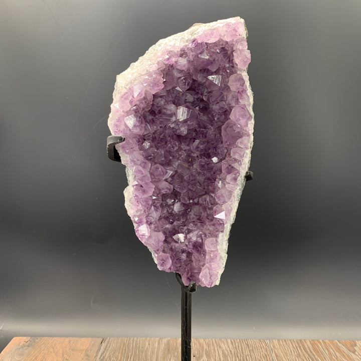 Amethyst druzy geode on iron stand