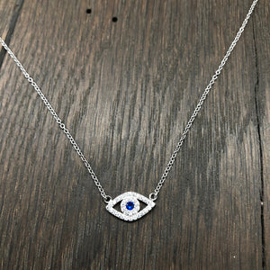 Evil eye protective layering necklace with pavé czs and blue cz eye