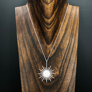 Pavé cz sunburst and tiny star necklace