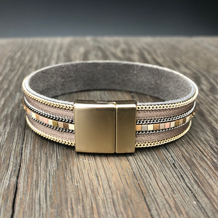 Metallic gray leather cuff with pewter beading