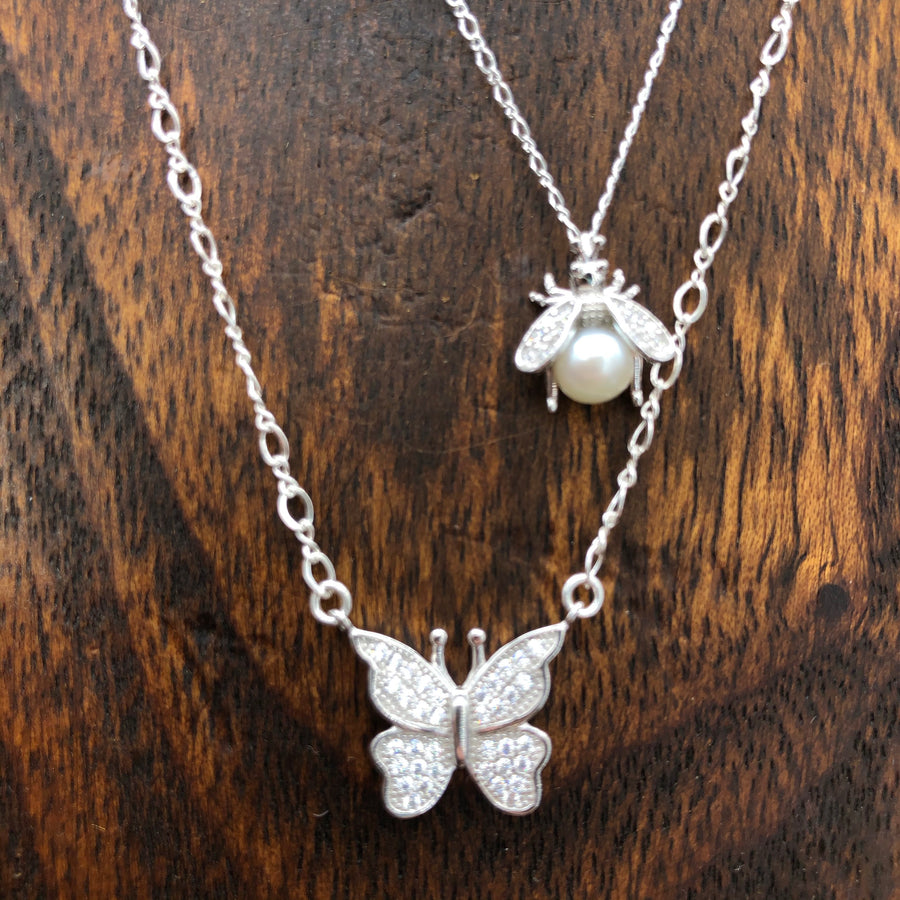 Pavé cz rosette, bee and butterfly three strand necklace
