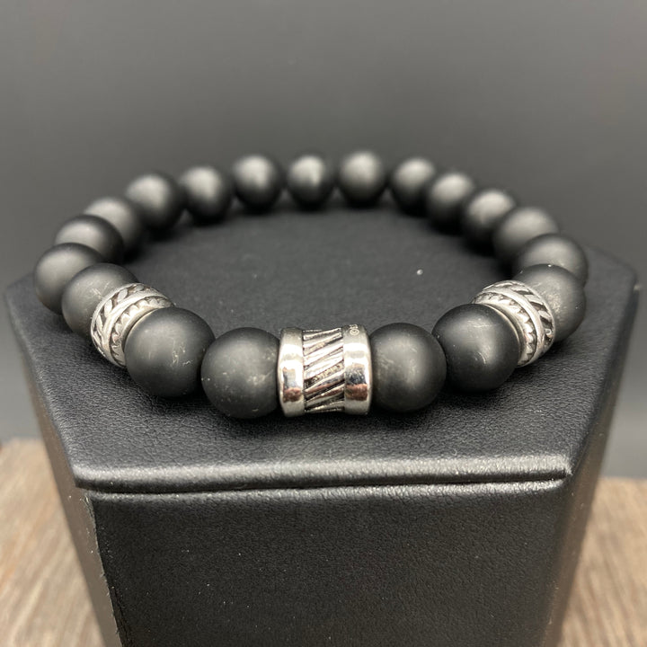Black bead bracelet with textured accents - silver