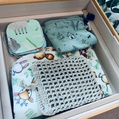 cotton rounds, unpapersg towels and crochet soap savers packed in reused mooncake gift boxes