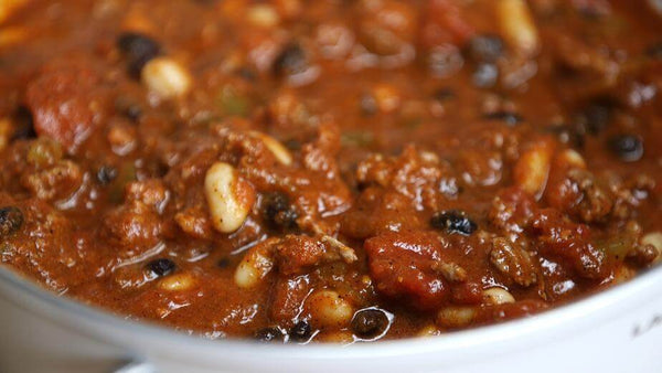 ic: homemade baked beans in a white bowl