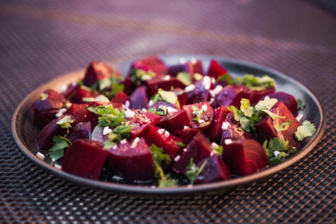 ic: salad with beetroot, feta, and parsely in a bowl