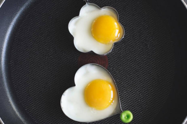 ic: eggs being cooked in moulds