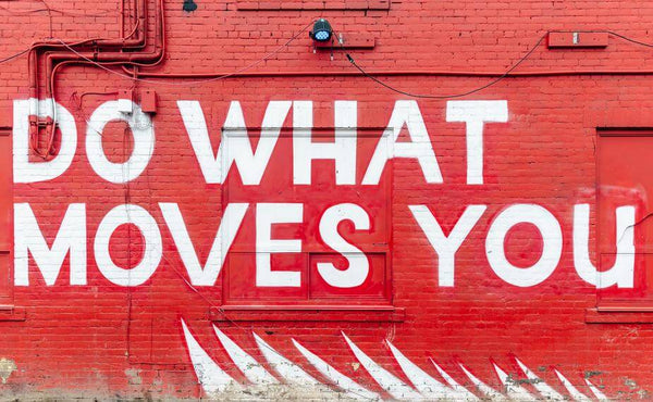 """ic: Red wall with the words """"Do What Moves You"""""""