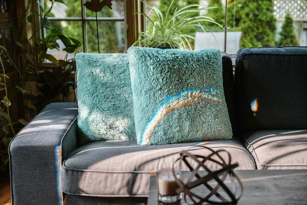Soft cushions on a sofa in a sunlit space in the house   Zen Space Ideas