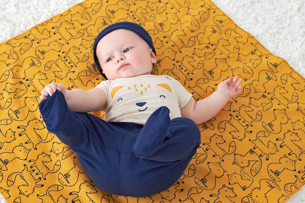 Baby Boy Lying Down on Flannel Blanket as a DIY Changing Pad for On the Go Diaper Changes