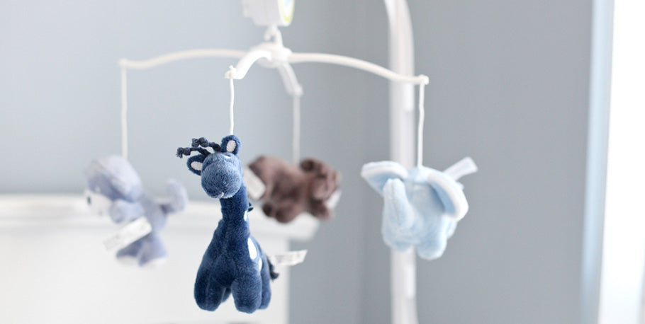 closeup baby mobile with stuffed animals