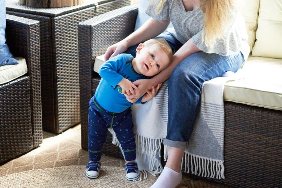 baby wearing blue outfit with shoes