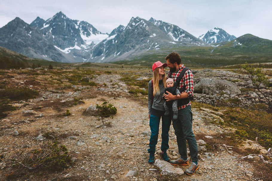 couple hiking with baby