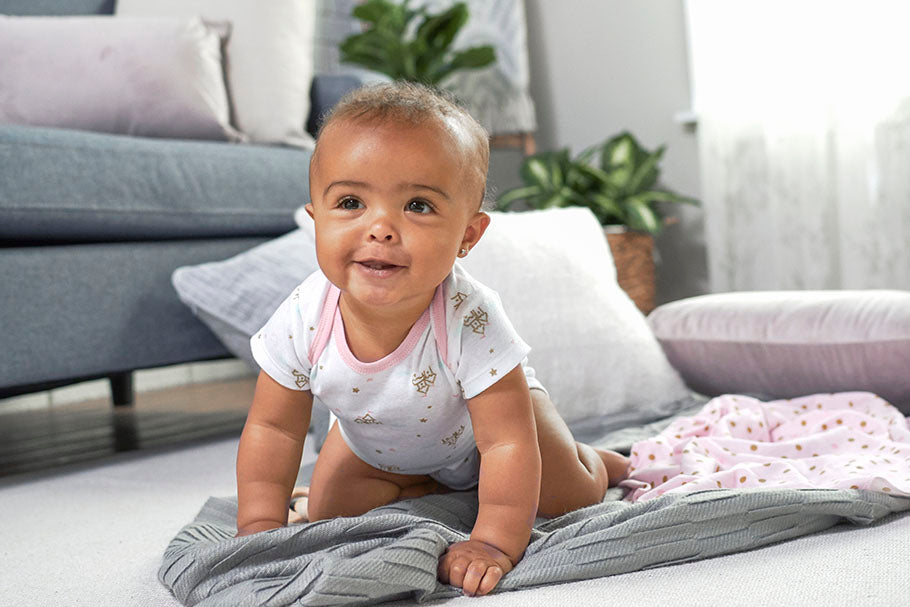 smiling and crawling child
