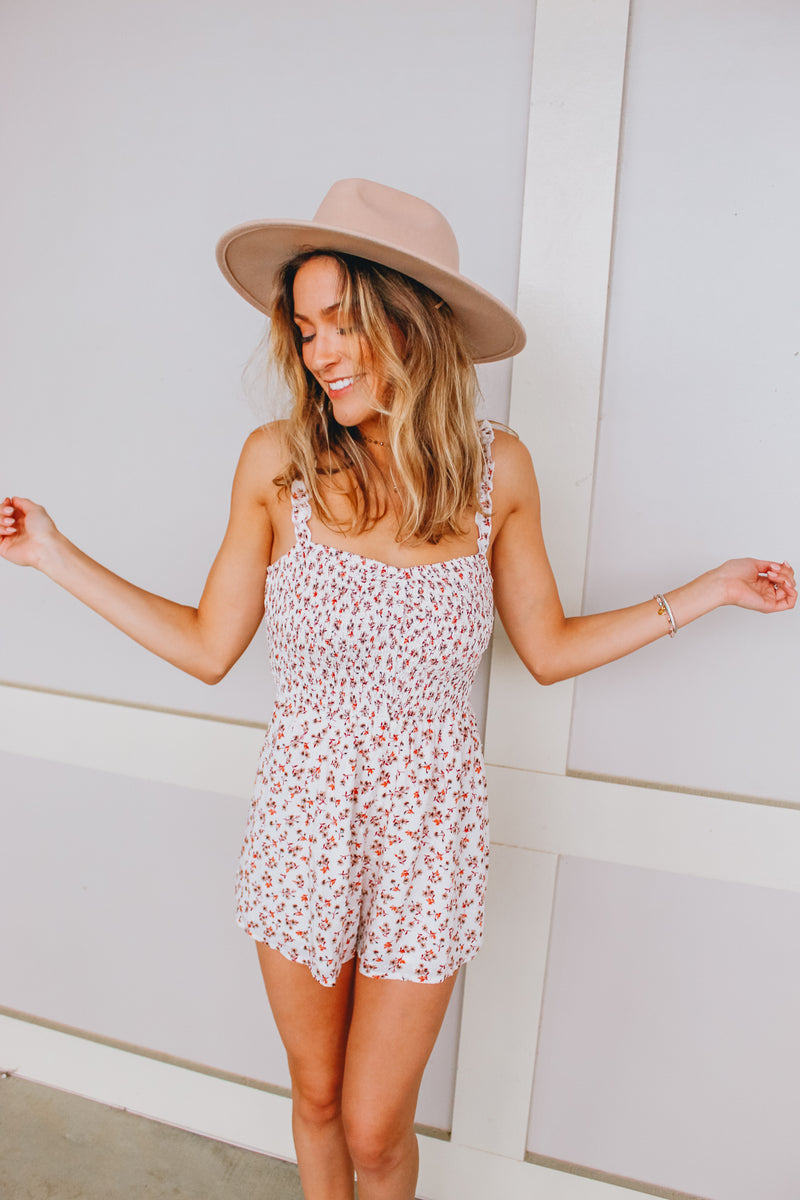 GIVE ME ABOUT A FLOWER ROMPER