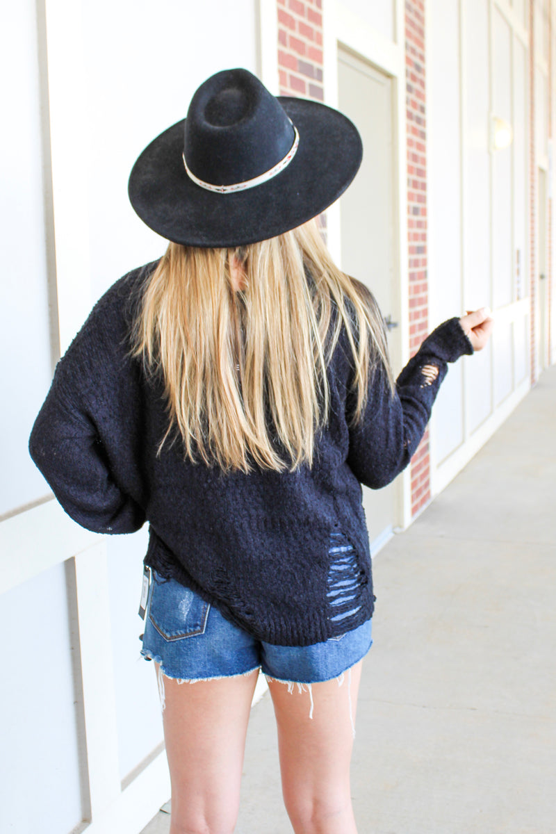 HOLE-Y MOLY DISTRESSED SWEATER