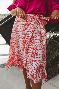 FAME AND FORTUNE WRAP SKIRT