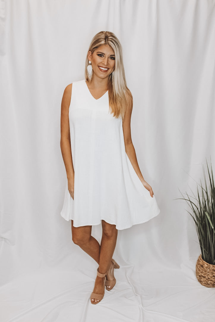 DRESSED IN WHITE DRESS