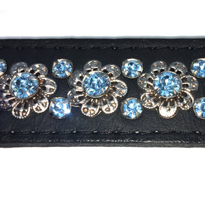 Black signature leather collar featuring intricate filigree design with blue crystals from Style Hound-detail view