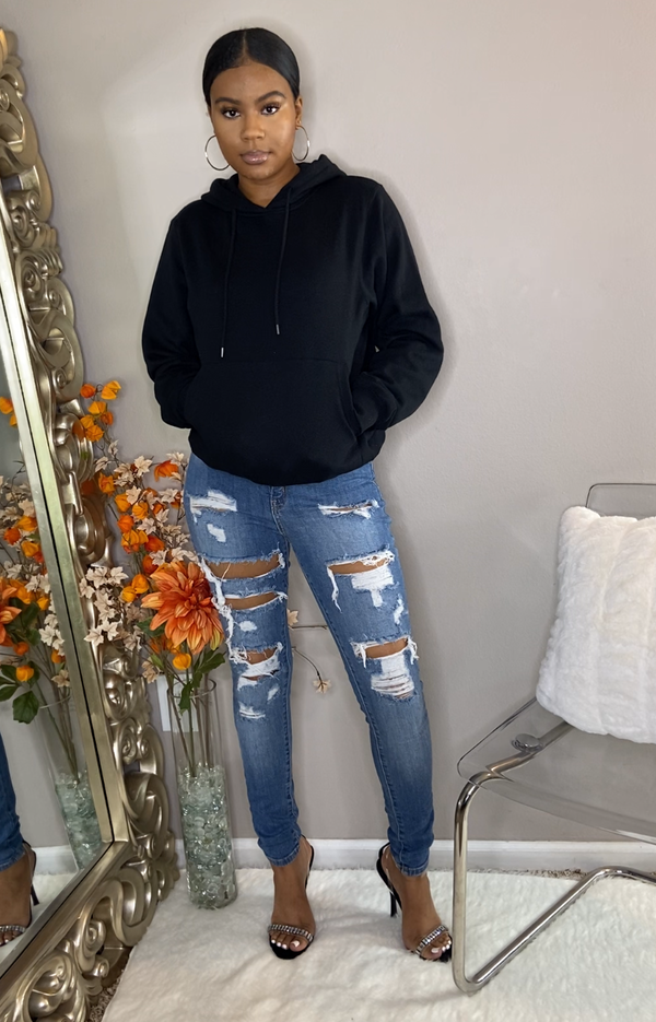 black classic pullover hoodie with kangaroo pouch adjustable drawstring blue jean denim ripped high waisted jeans