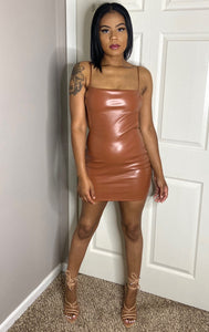 Brown PU LEATHER MINI DRESS WITH OPEN BACK. LITTLE STRETCH AND FORM FITTING. STRETCHY ADJUSTABLE STRAPS AND HIDDEN ZIPPER CLOSURE sexy dress detroit black owned boutique
