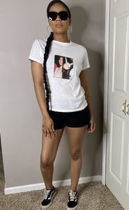 Nicki Minaj wavy hair Barbz middle finger white t shirt paired with biker shorts and black/white vans street style