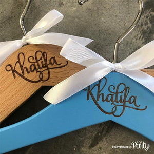 Customised set of 4 children's engraved wooden hangers -  The Party
