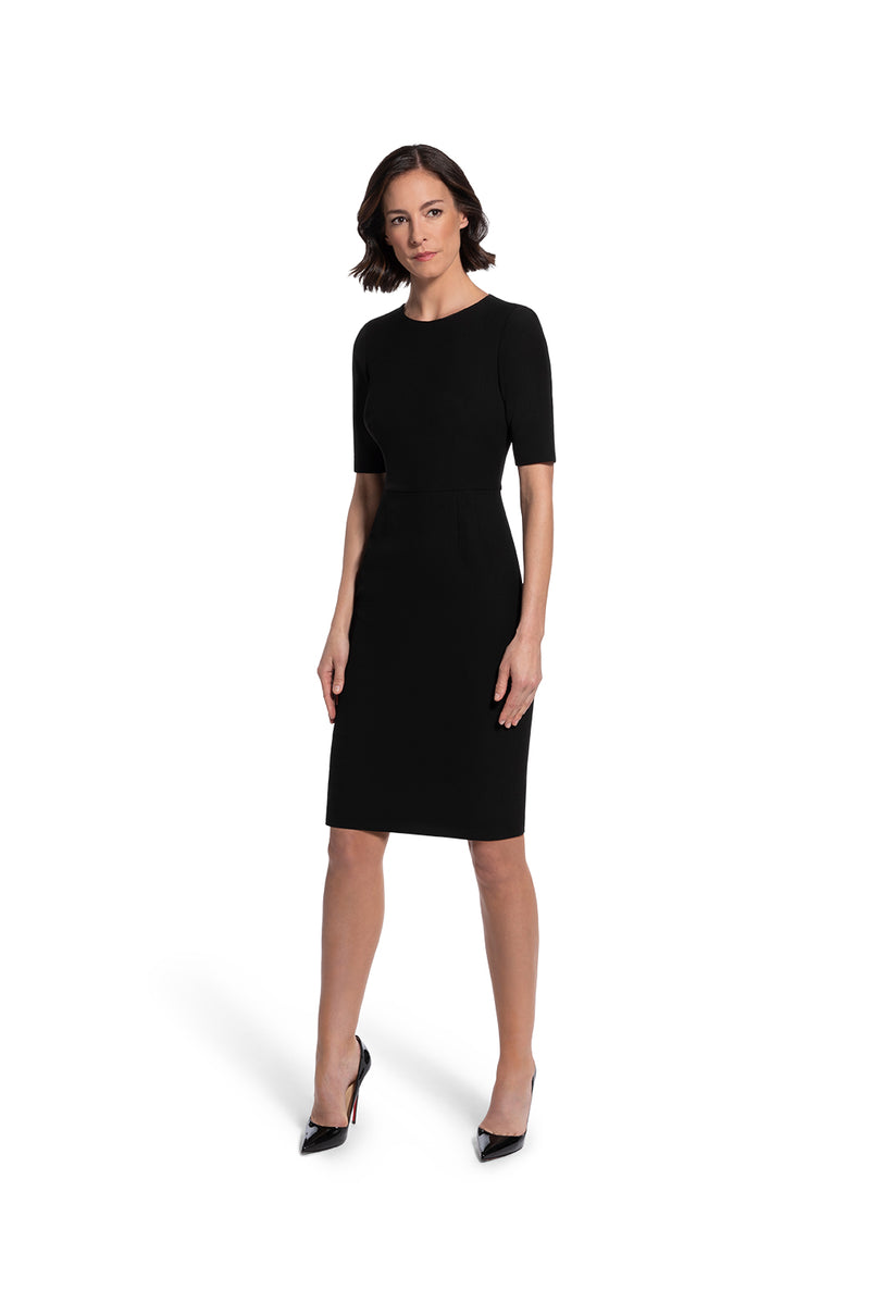 front view of woman 1 wearing the black alpha dress bring it on black collection