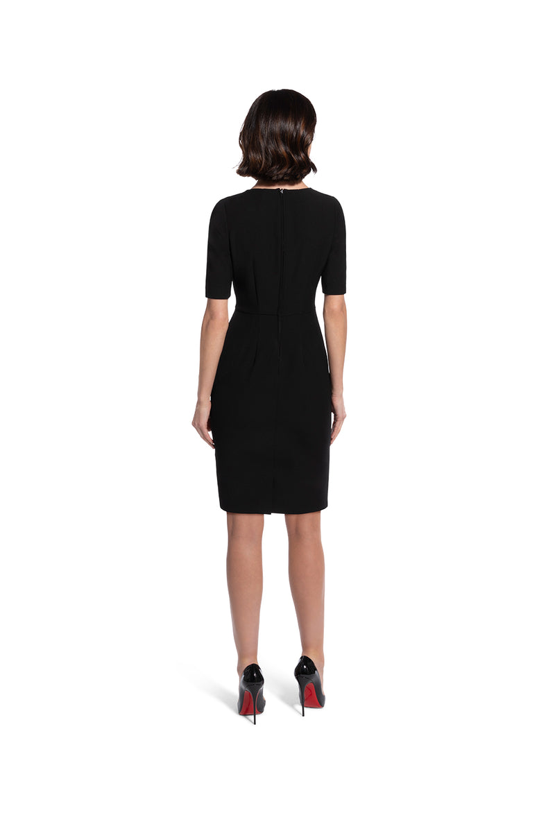 back view of woman 1 wearing the black alpha dress Bring It On Black hover Collection hover