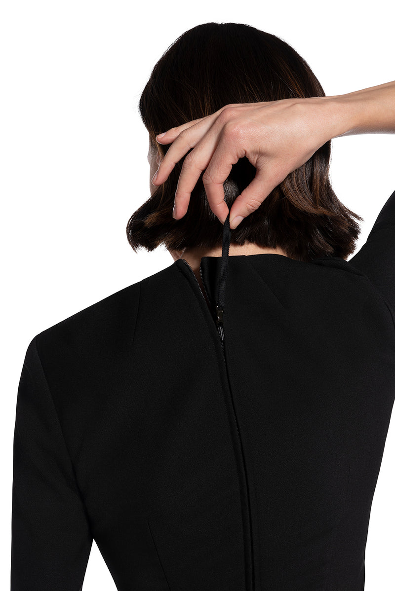 close-up back view of re-engineered zipper on woman 1 wearing the black alpha dress bring it on black collection