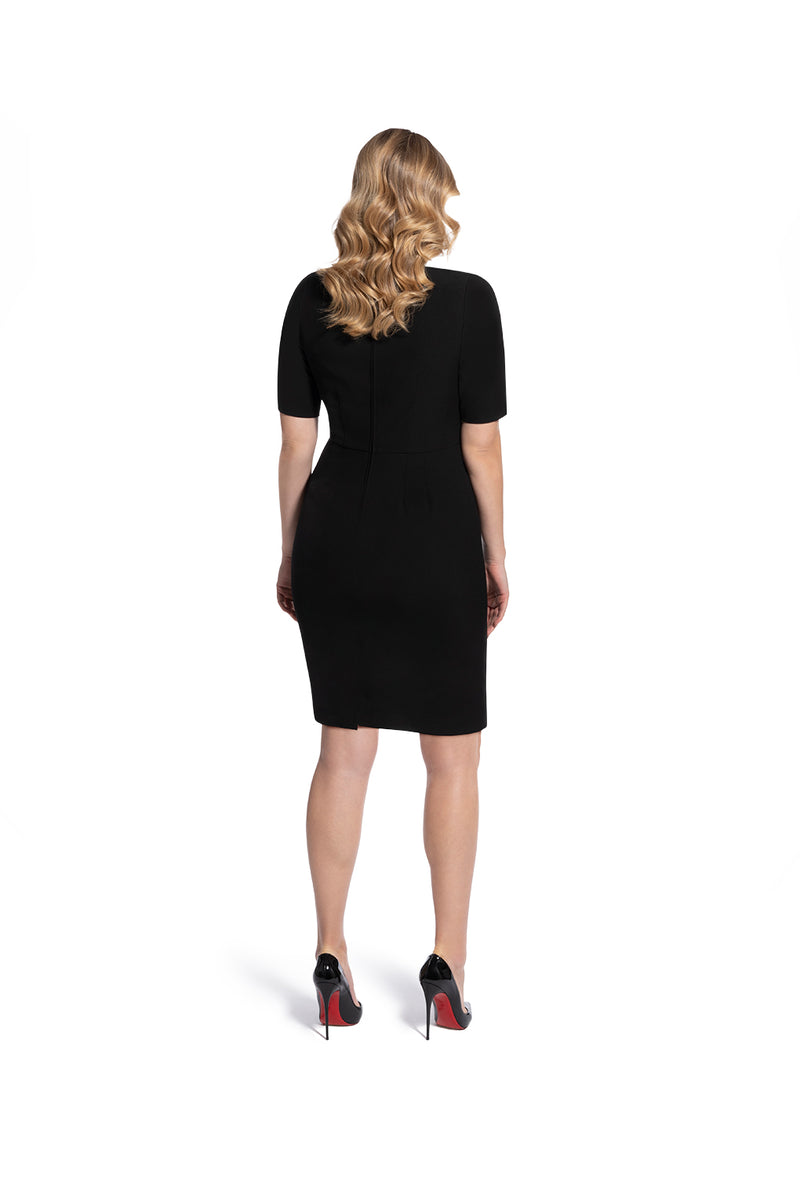 back view of woman 2 wearing the black alpha dress bring it on black collection