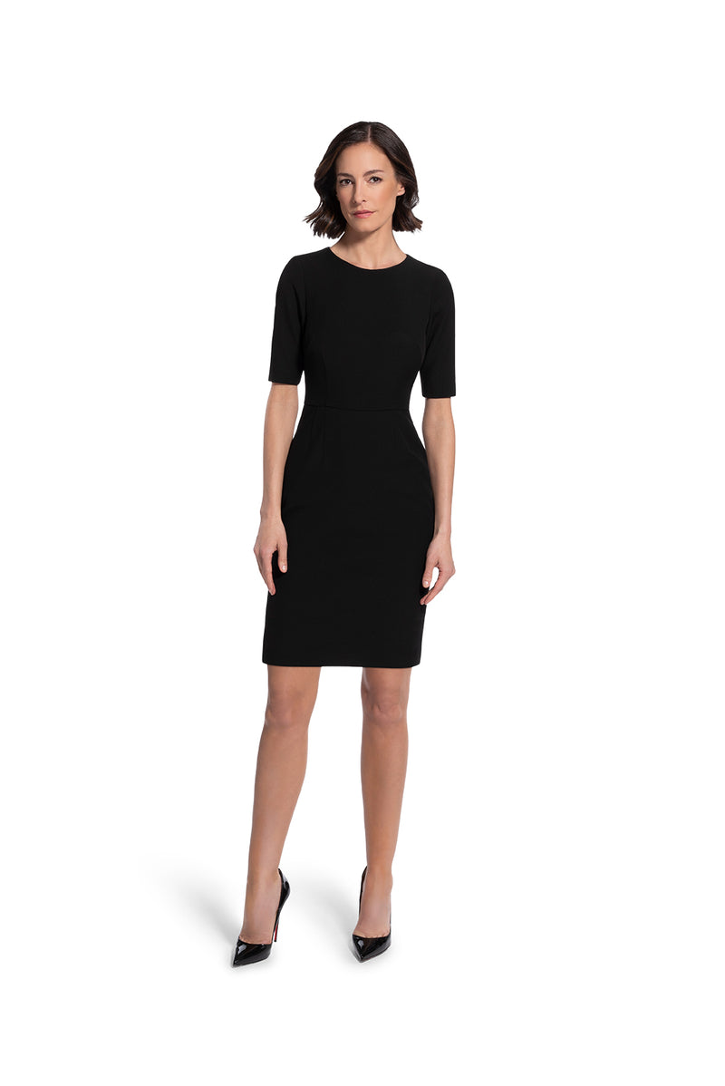 front view of woman wearing the black alpha dress bring it on black collection